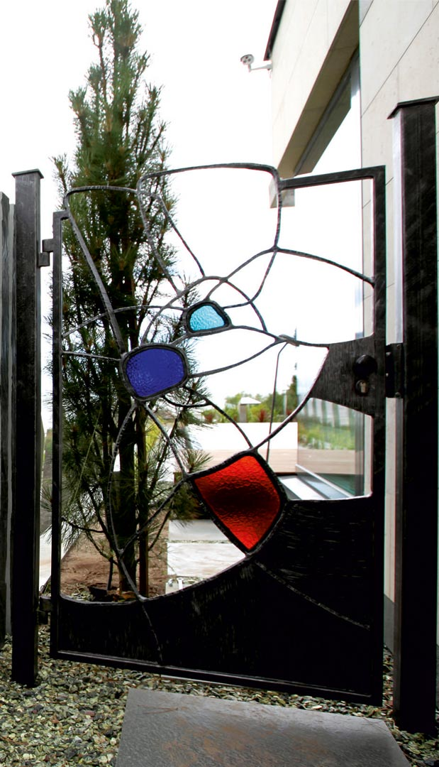Forged metal gates, coated with hot zinc, painted, stained glass.